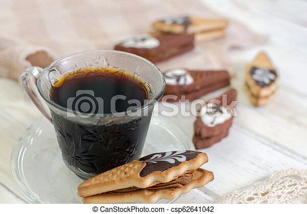 Cup of coffee with cookies. on white wooden board. - csp62641042