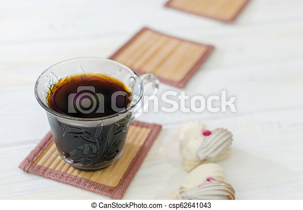 Cup of coffee with cookies. on white wooden board. - csp62641043
