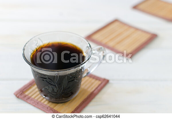 Cup of coffee with cookies. on white wooden board. - csp62641044