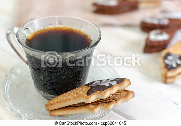 Cup of coffee with cookies. on white wooden board. - csp62641045
