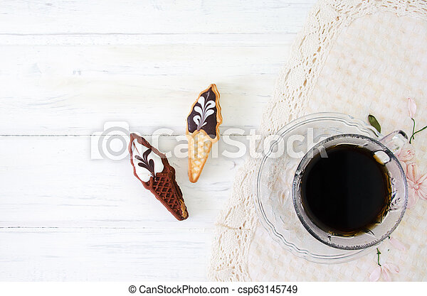 Cup of coffee with cookies. on white wooden board. - csp63145749