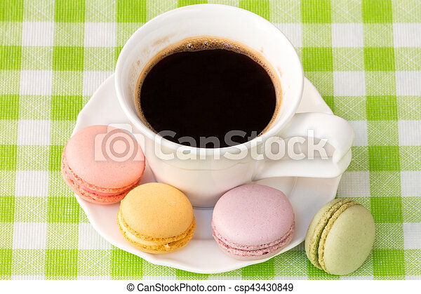 Cup of coffee with french macaroons - csp43430849