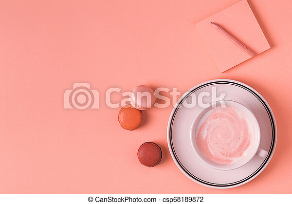 Cup of coffee with macaroons on pastel background. - csp68189872