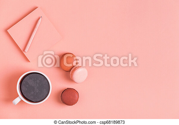 Cup of coffee with macaroons on pastel background. - csp68189873