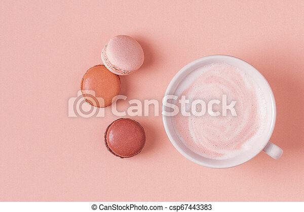 Cup of coffee with macaroons on pastel background. - csp67443383