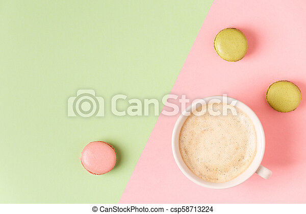 Cup of coffee with macaroons on pastel background. - csp58713224