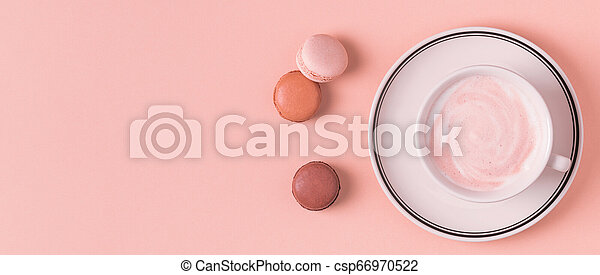 Cup of coffee with macaroons on pastel background. - csp66970522
