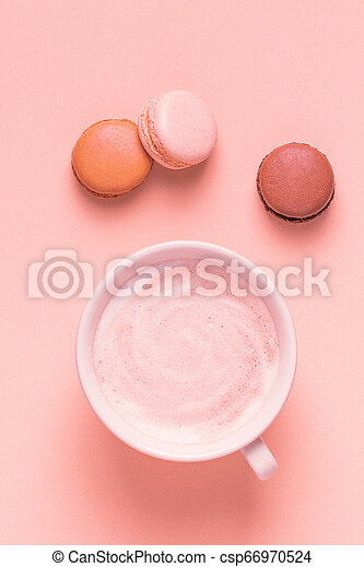 Cup of coffee with macaroons on pastel background. - csp66970524
