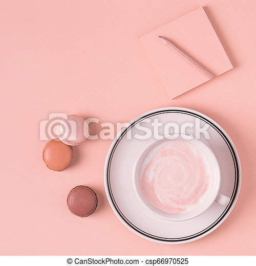 Cup of coffee with macaroons on pastel background. - csp66970525