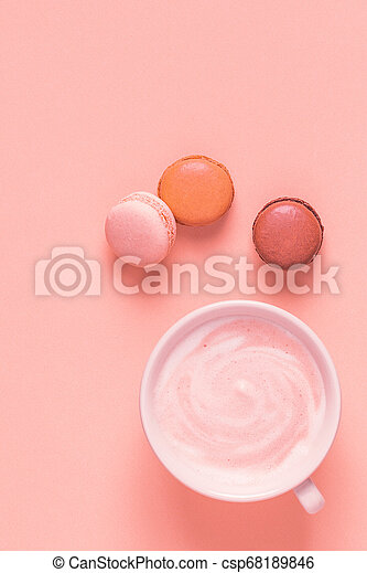 Cup of coffee with macaroons on pastel background. - csp68189846