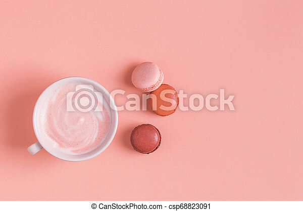 Cup of coffee with macaroons on pastel background. - csp68823091