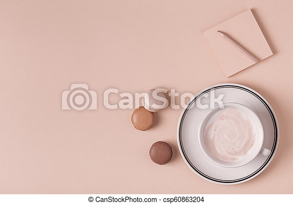 Cup of coffee with macaroons on pastel background. - csp60863204