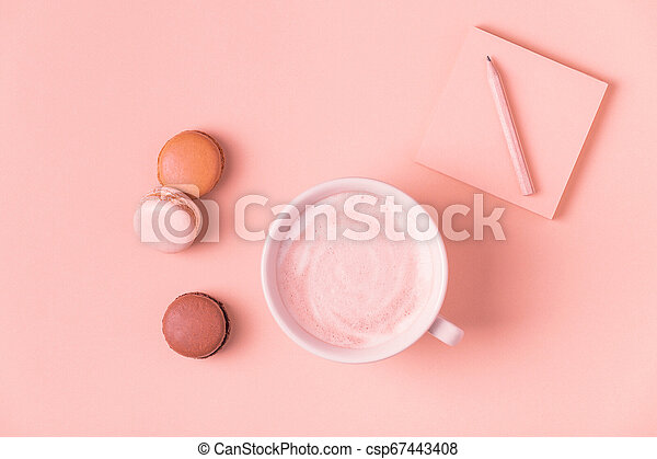 Cup of coffee with macaroons on pastel background. - csp67443408