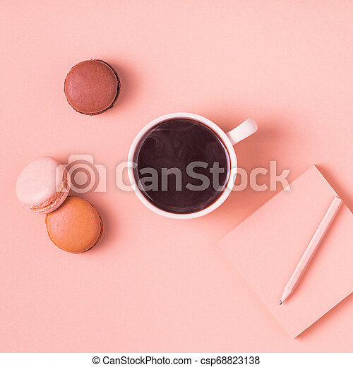 Cup of coffee with macaroons on pastel background. - csp68823138
