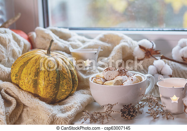 Cup of coffee with marshmallow on windowsill, cozy home concept - csp63007145