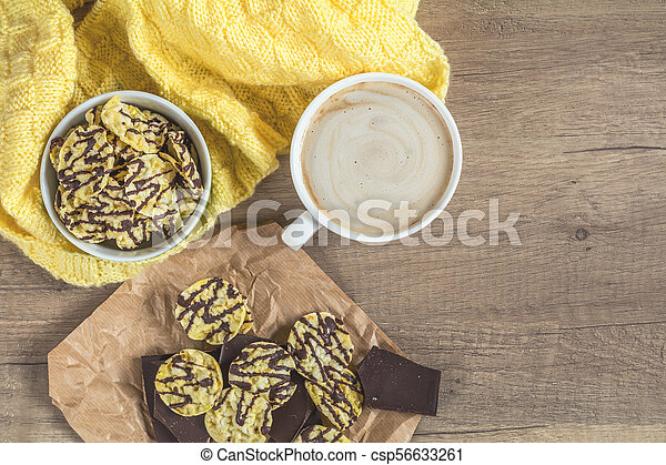 Cup of coffee with milk, chocolate, delicious nutritious cereal breads - csp56633261