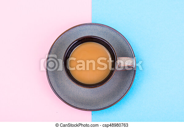 Cup of coffee with milk on pastel background - csp48980763