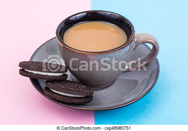 Cup of coffee with milk on pastel background - csp48980751