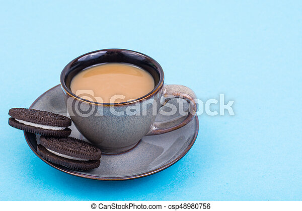 Cup of coffee with milk on pastel background - csp48980756