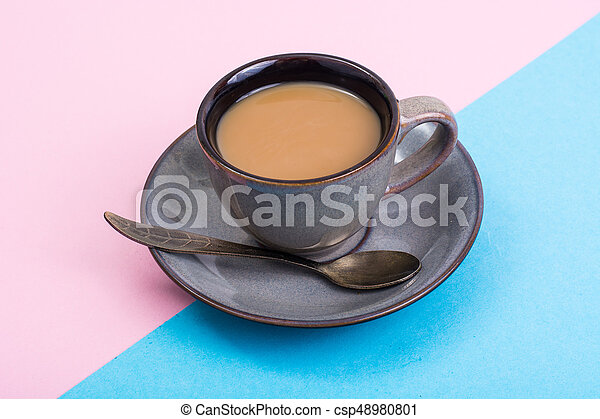 Cup of coffee with milk on pastel background - csp48980801