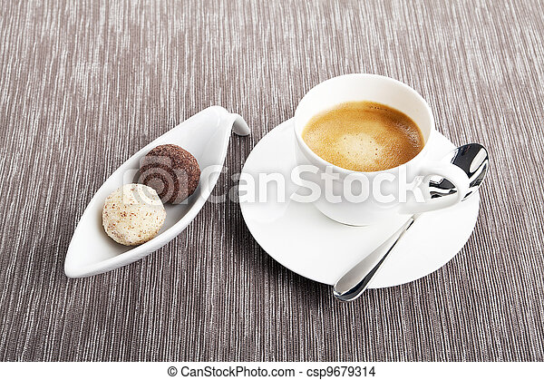 cup of coffee with mixed pralines - csp9679314