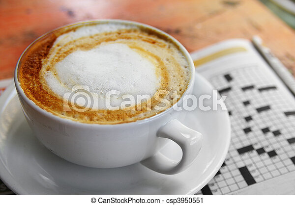 cup of coffee with morning paper, crossword puzzle - csp3950551