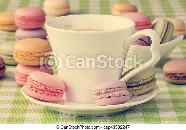 Cup of coffee with sweet macaroon biscuits - csp43532247