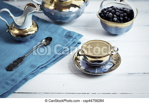 cup of espresso black coffee on a white wooden surface - csp44756284