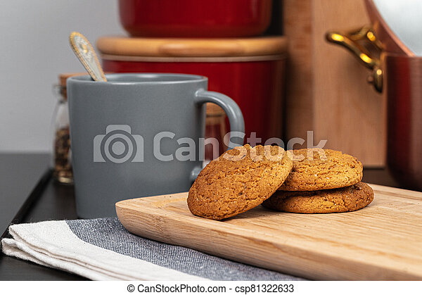 Cup of hot coffee on wooden board on kitchen table - csp81322633