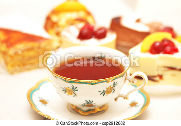 Cup of tea and various cakes -shallow DOF - csp2912682