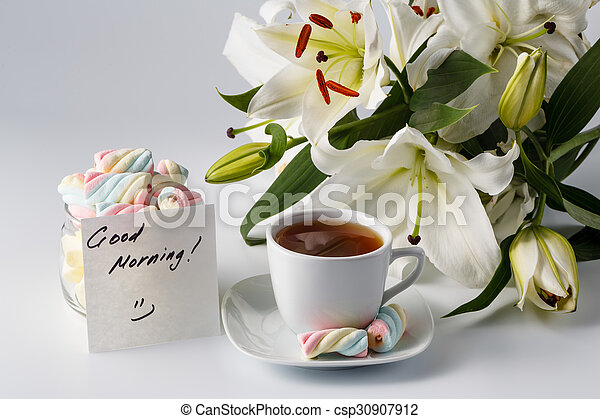 cup-of-tea-white-lily-and-note-picture_csp30907912.jpg