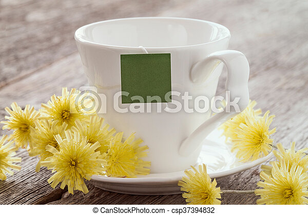Cup of tea with blank tag. - csp37394832