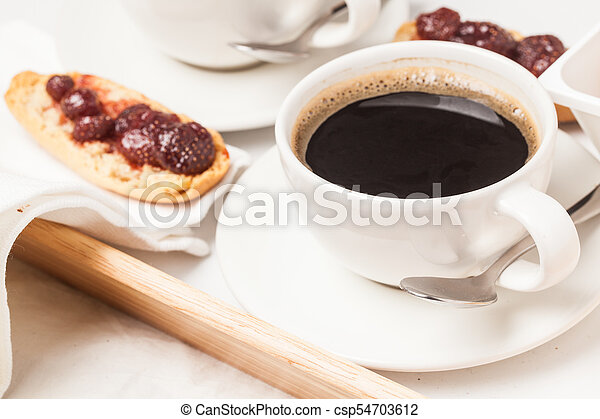 cup tea on bed tray - csp54703612