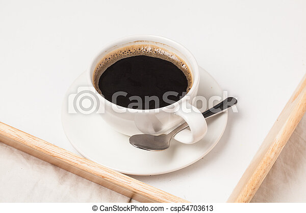 cup tea on bed tray - csp54703613