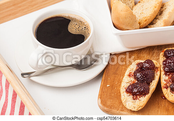 cup tea on bed tray - csp54703614