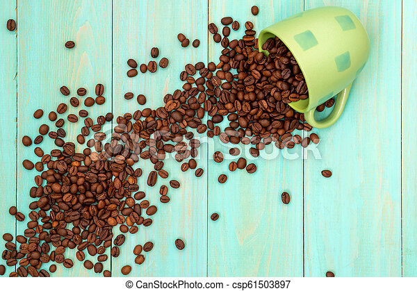 Cup with scattered coffee beans - csp61503897