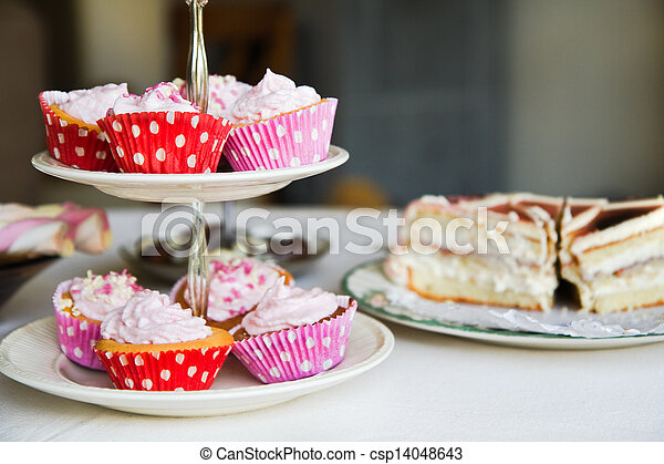 Cupcakes And Birthday Cake On A Table