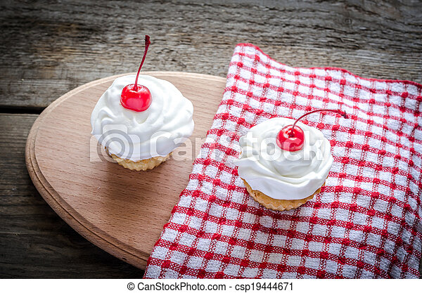 Cupcakes with whipped cream - csp19444671