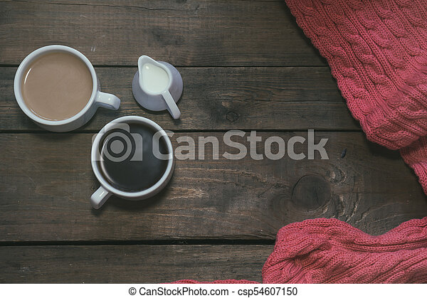 Cups of coffee on dark wooden background. - csp54607150