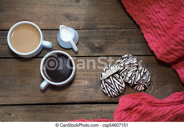 Cups of coffee on dark wooden background. - csp54607151