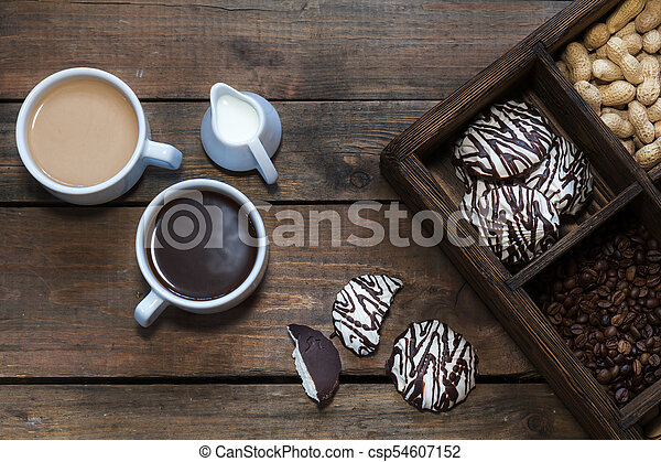 Cups of coffee on dark wooden background. - csp54607152
