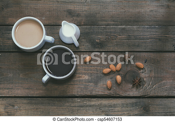 Cups of coffee on dark wooden background. - csp54607153