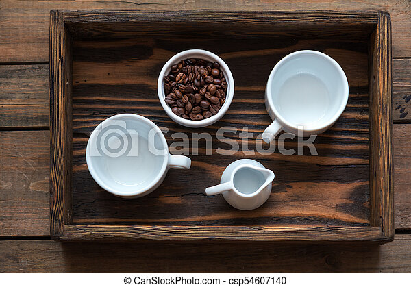 Cups of coffee on dark wooden background. - csp54607140