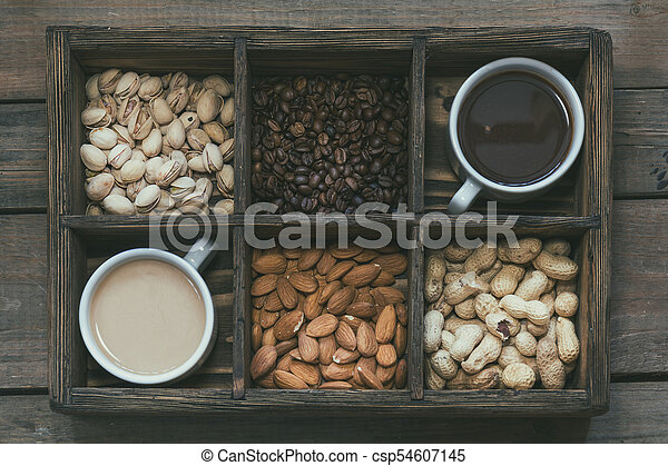 Cups of coffee on dark wooden background. - csp54607145