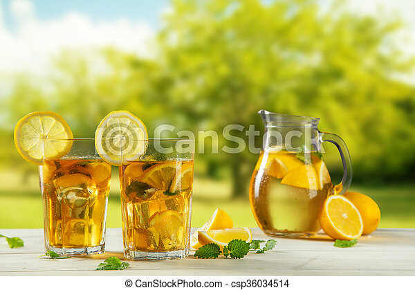 Cups of ice tea with trees on background - csp36034514