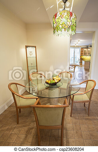 Curcular table in dining room - csp23608204
