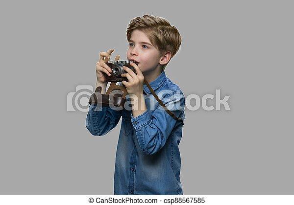 Curious caucasian boy using binoculars. - csp88567585