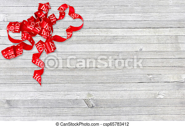 curly Christmas ribbon on old wood - csp65783412