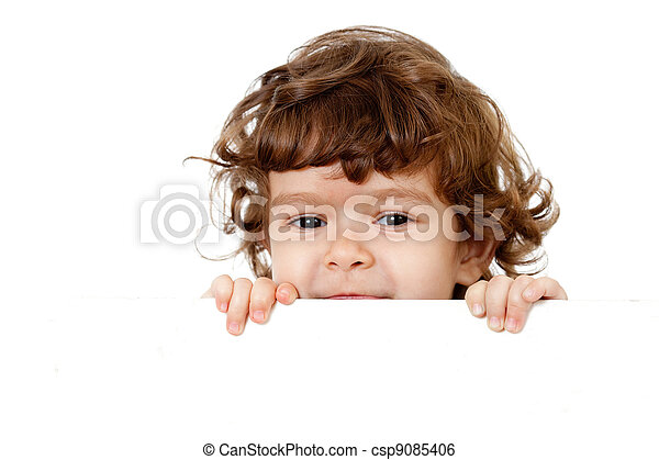 Curly funny child face holding blank advertising banner - csp9085406