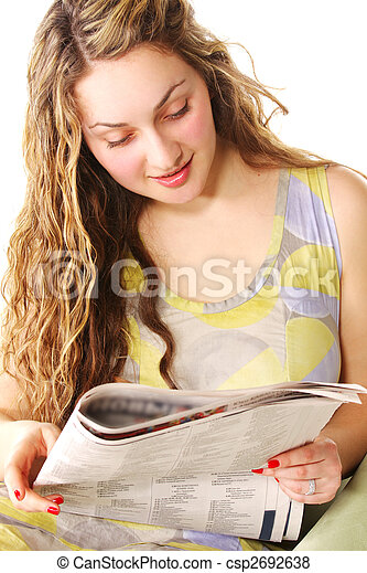 Curly woman reading newspaper - csp2692638